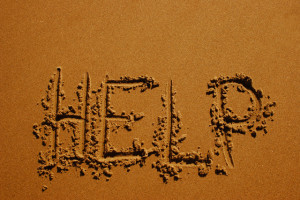 HELP Written in the Sand --- Image by © Christine Mariner/Design Pics/Corbis